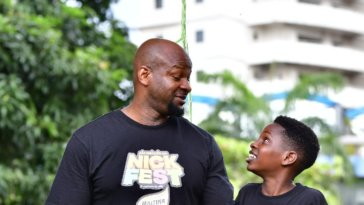 Alex Okosi and son at Nickfest